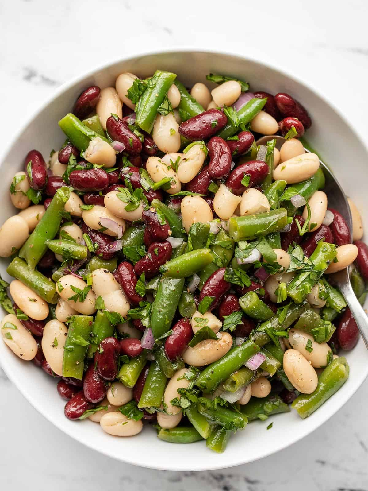 Overhead view of a bowl full of three bean salad