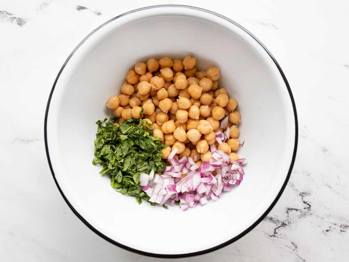 Chickpeas, onions, and cilantro in a bowl