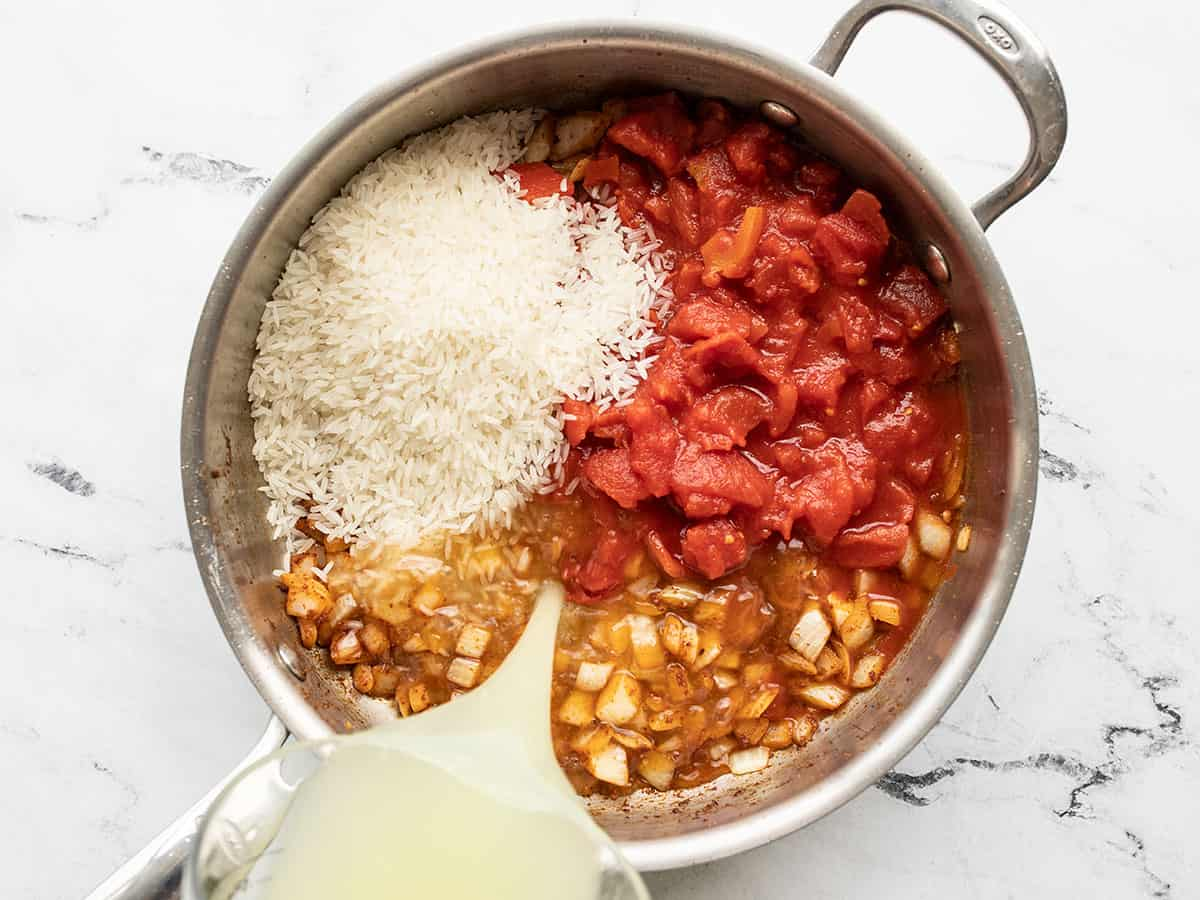 diced tomatoes, rice, and broth added to the skillet