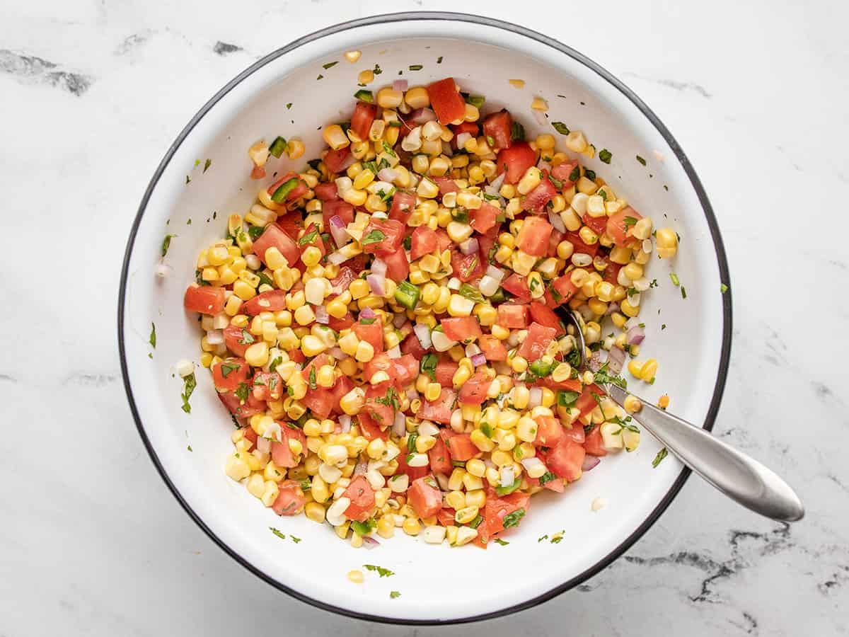 Stirred fresh corn salsa in the bowl