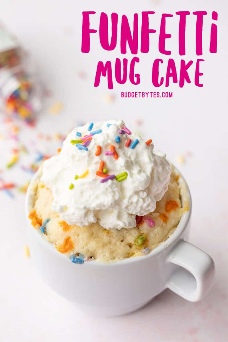 a funfetti mug cake topped with whipped cream, pink title text at the top