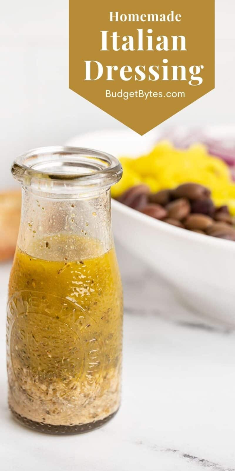 Italian dressing in a glass carafe with title text at the top