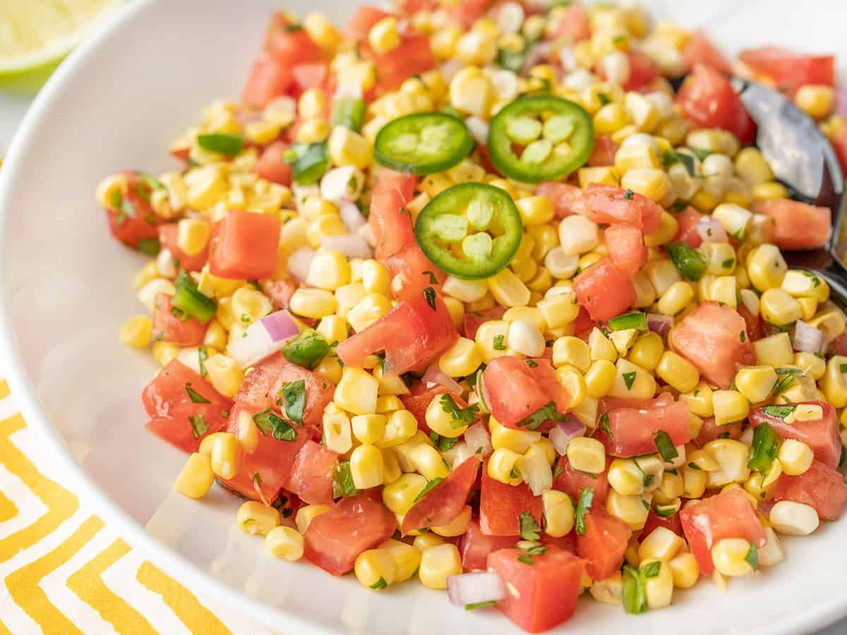 Close up shot of fresh corn salsa from the side