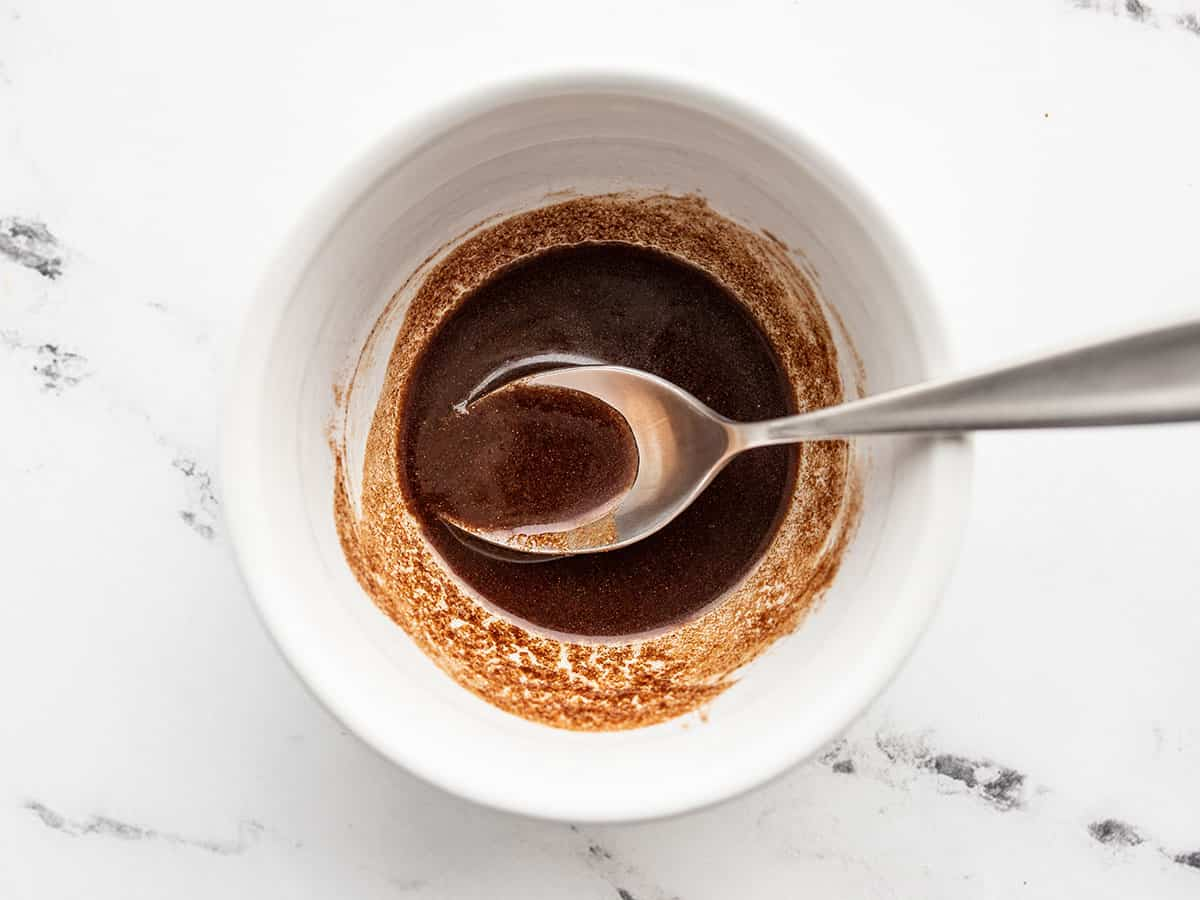 metled butter, brown sugar, and cinnamon in a bowl with a spoon