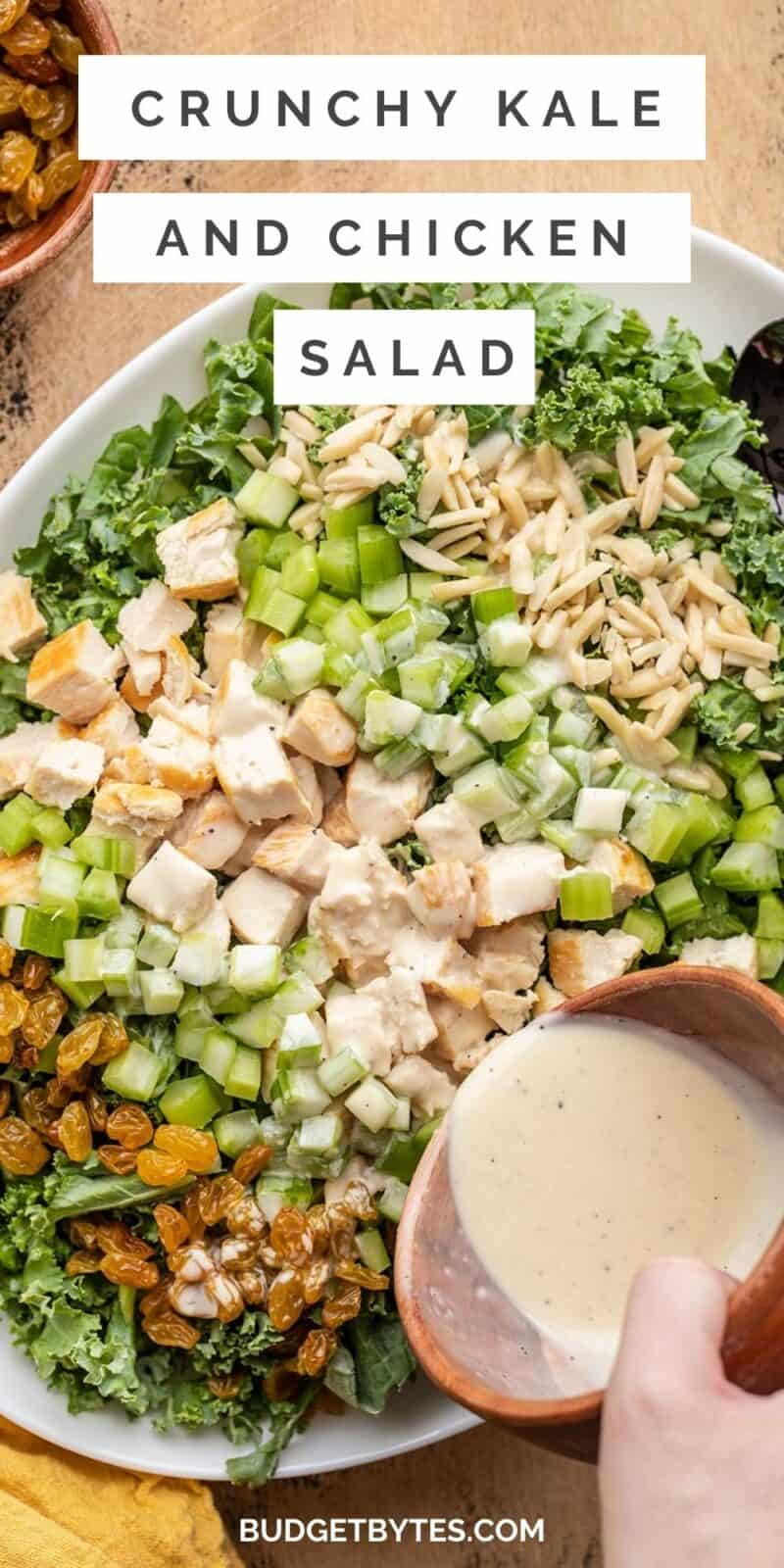 Close up of dressing being poured over kale and chicken salad, title text at the top