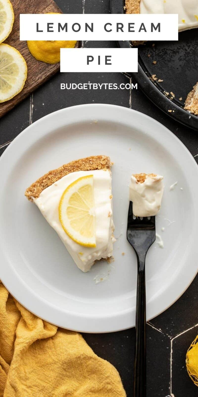 one slice of lemon cream pie on a plate with a fork