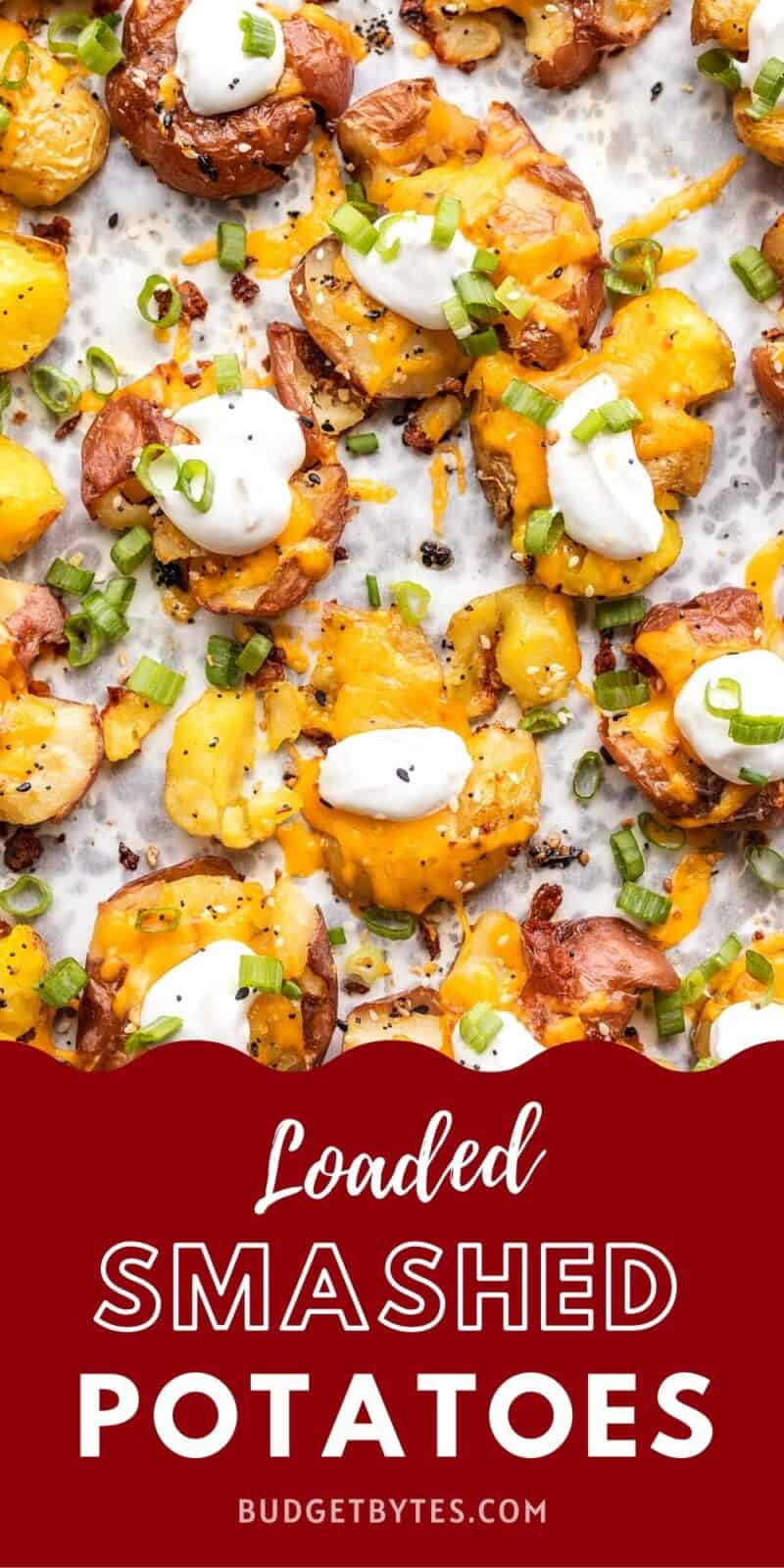 overhead view of loaded smashed potatoes on a baking sheet, title text at the bottom