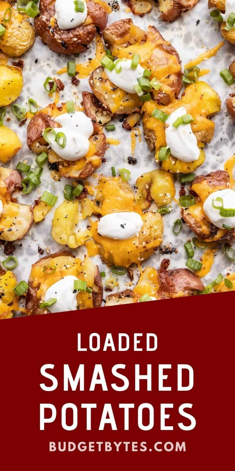 close up of loaded smashed potatoes on a baking sheet, title text at the bottom