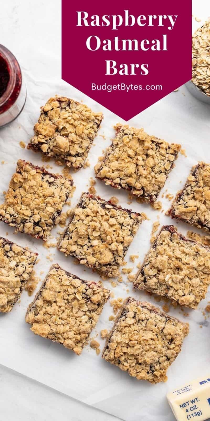 Overhead view of cut raspberry oatmeal bars, title text at the top