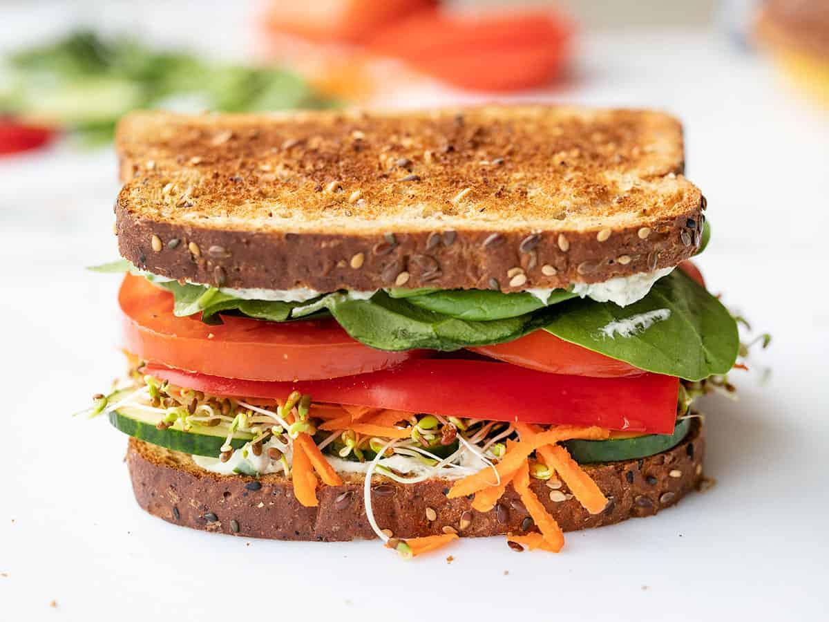 Side view of a closed veggie sandwich, uncut