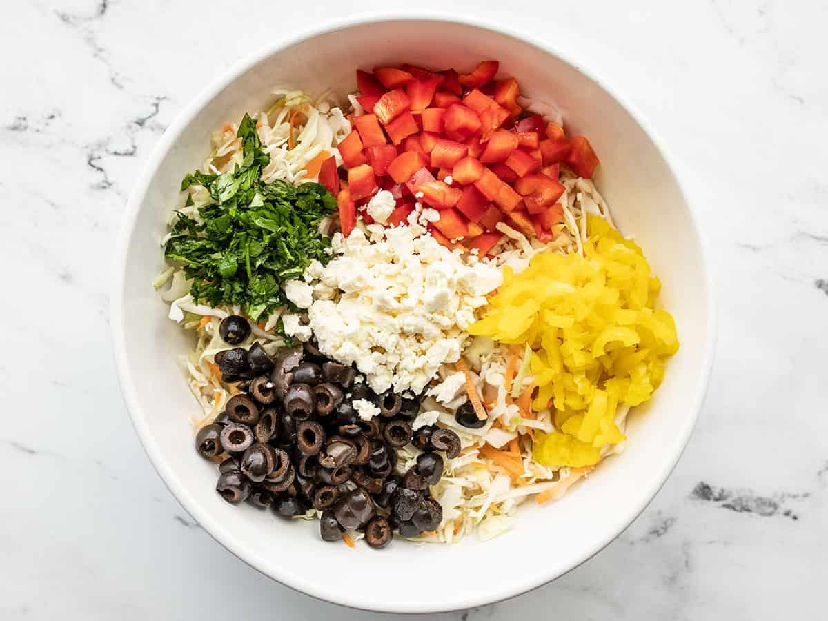 prepped vegetables for mediterranean slaw in a bowl