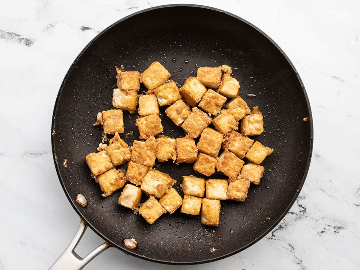 cooked tofu cubes in a skillet