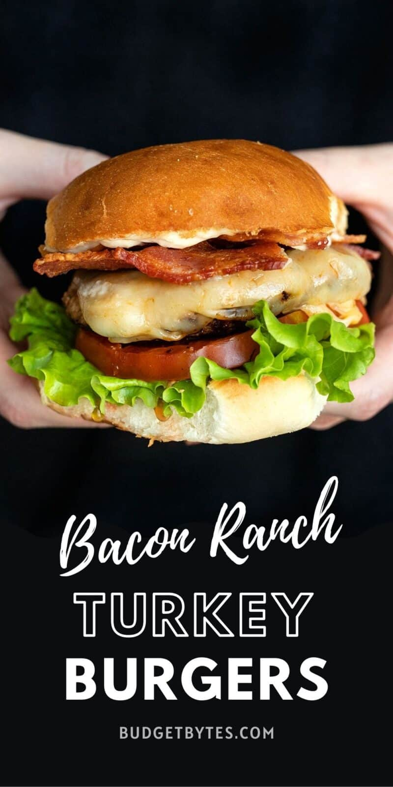 a single bacon ranch turkey burger held in hands, title text at the bottom