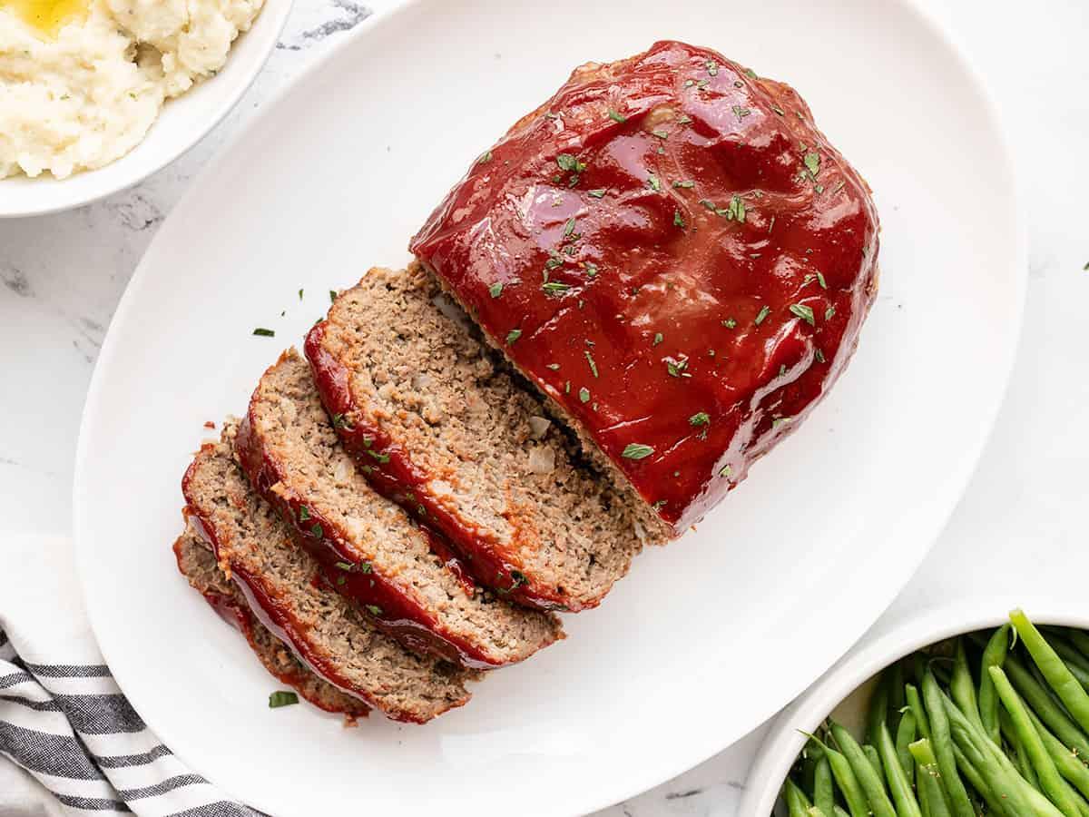 Overhead view of sliced meatloaf on a platter