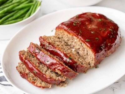 Side view of sliced meatloaf on a platter