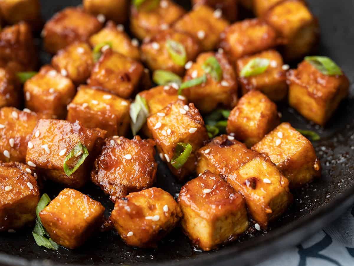 Close up of honey sriracha tofu in the skillet