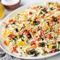 Side view of mediterranean coleslaw in a serving dish