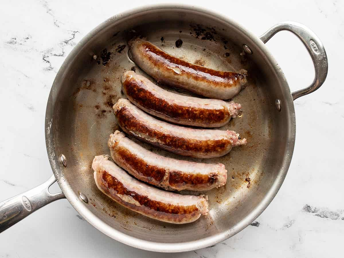 Browned bratwurst in a skillet