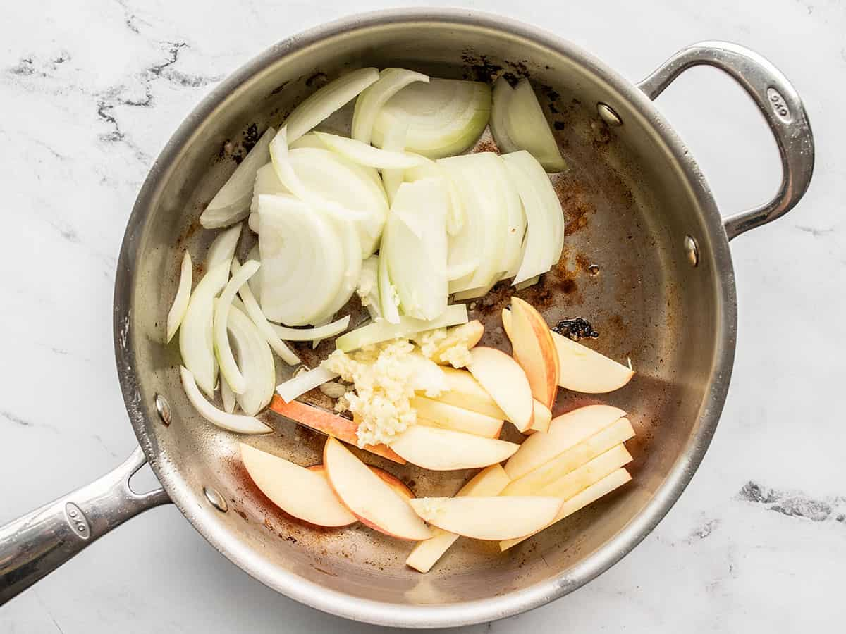 onions and apples added to the skillet
