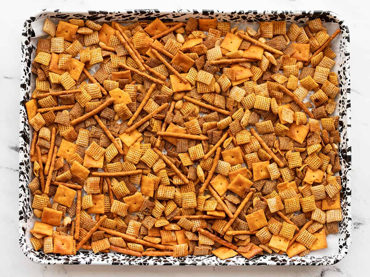 Baked snack mix on the baking sheet