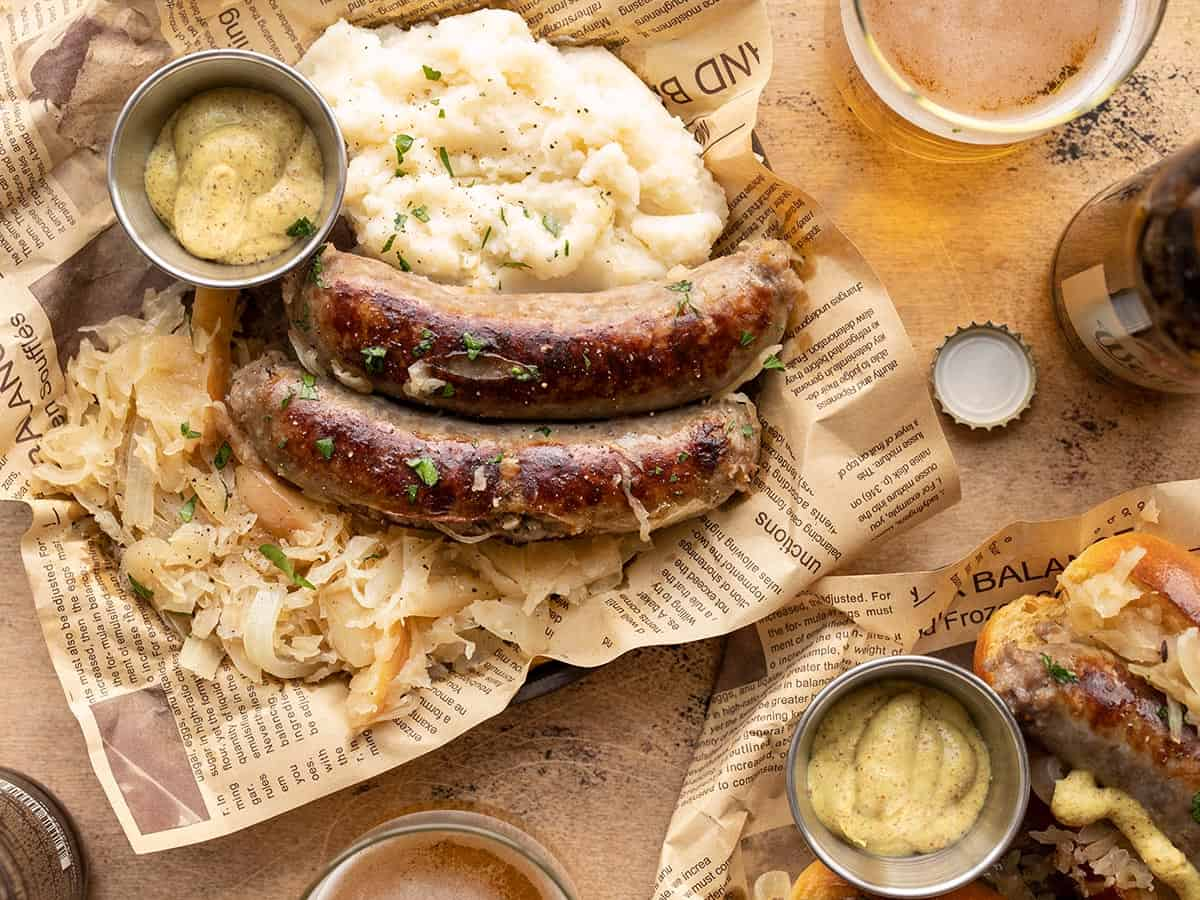 Bratwurst and sauerkraut on a plate with mashed potatoes and mustard