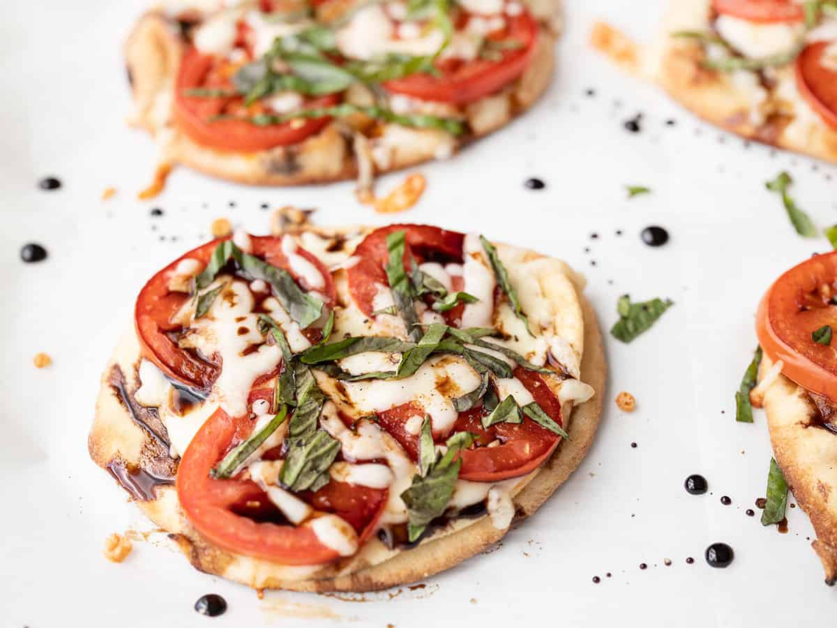 Close up side view of a caprese pizza
