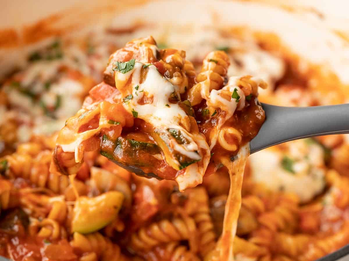 Close up of one pot veggie pasta being lifted on a spoon