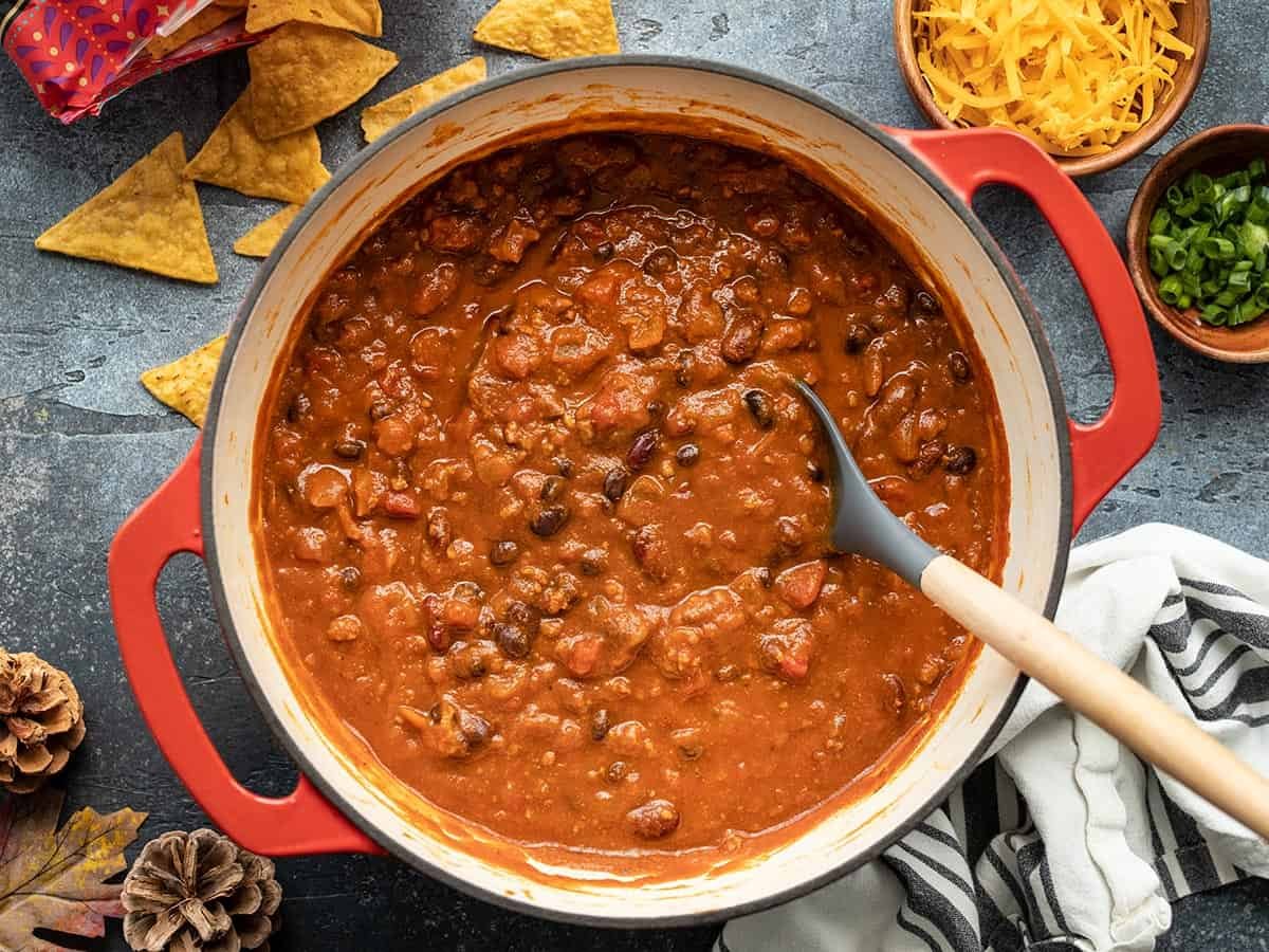 Overhead view of a pot of pumpkin chili
