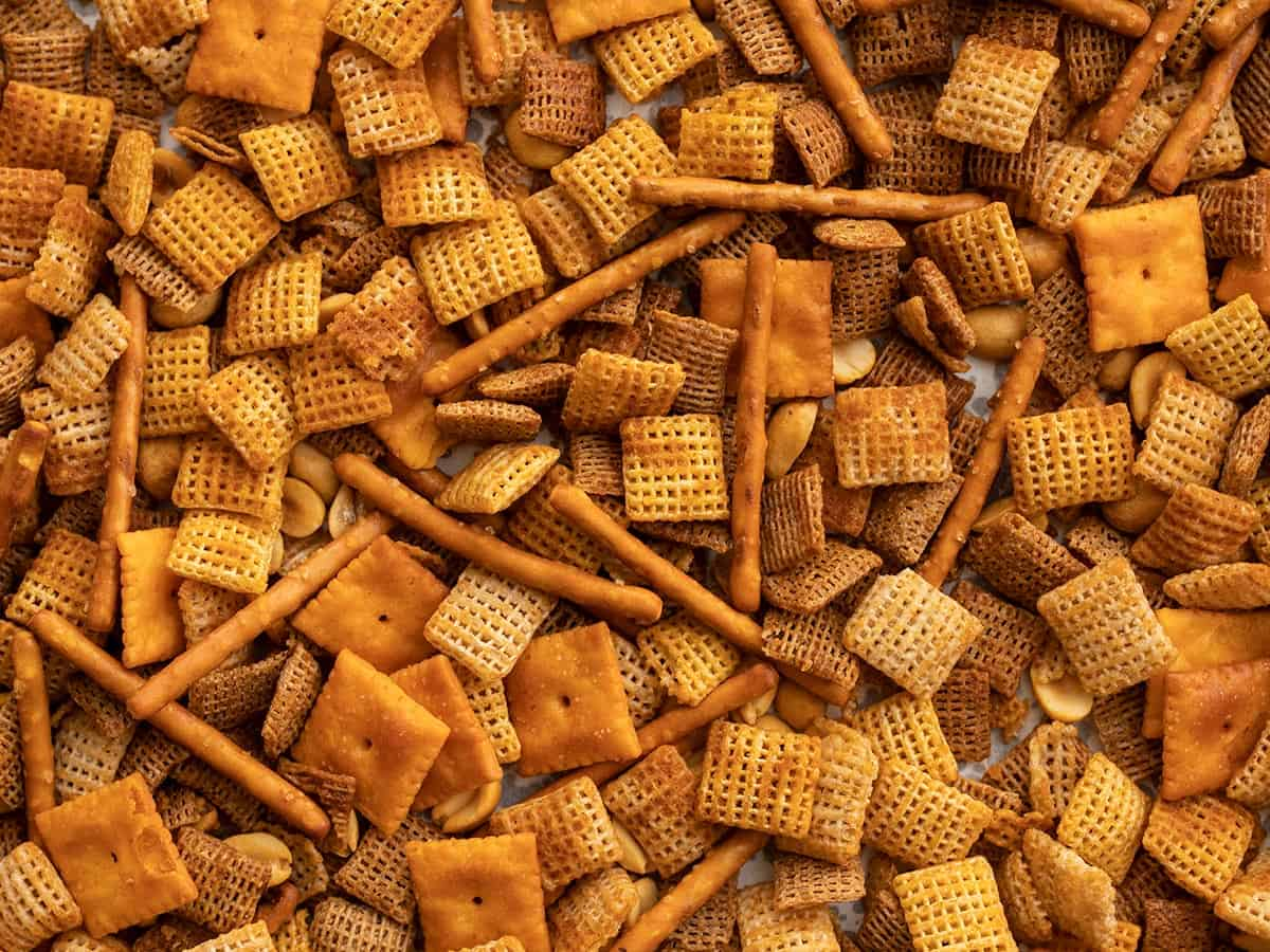 Close up of spicy chex mix on the baking sheet